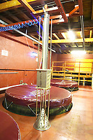 In the Chapoutier winery. Wooden fermentation vat from above with the machine used for pigeage (pressing punching down the cap of grape skins and solid matter when the wine ferments) in the foreground.  Domaine M Chapoutier, Tain l'Hermitage, Drome Drôme, France Europe