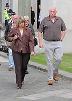 Pictured L-R: The mother of Joshua Davies, Hayley and his father Steven coming out of Swansea Crown court after their son's sentence. Friday 02 September 2011<br />