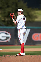 Georgia Bulldogs relief pitcher Cole Wilcox (13) looks to his catcher for the sign against the LSU Tigers at Foley Field on March 23, 2019 in Athens, Georgia. The Bulldogs defeated the Tigers 2-0. (Brian Westerholt/Four Seam Images)