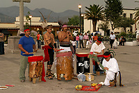 Young Mexican men dressed in pre-Hispanic costumes playing musical instruments  in Tepotzotlan, Mexico