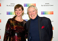 Jacque D'Amboise and his daughter-in-law, Kelly D'Amboise arrive for the formal Artist's Dinner honoring the recipients of the 40th Annual Kennedy Center Honors hosted by United States Secretary of State Rex Tillerson at the US Department of State in Washington, D.C. on Saturday, December 2, 2017. The 2017 honorees are: American dancer and choreographer Carmen de Lavallade; Cuban American singer-songwriter and actress Gloria Estefan; American hip hop artist and entertainment icon LL COOL J; American television writer and producer Norman Lear; and American musician and record producer Lionel Richie. Photo Credit: Ron Sachs/CNP/AdMedia