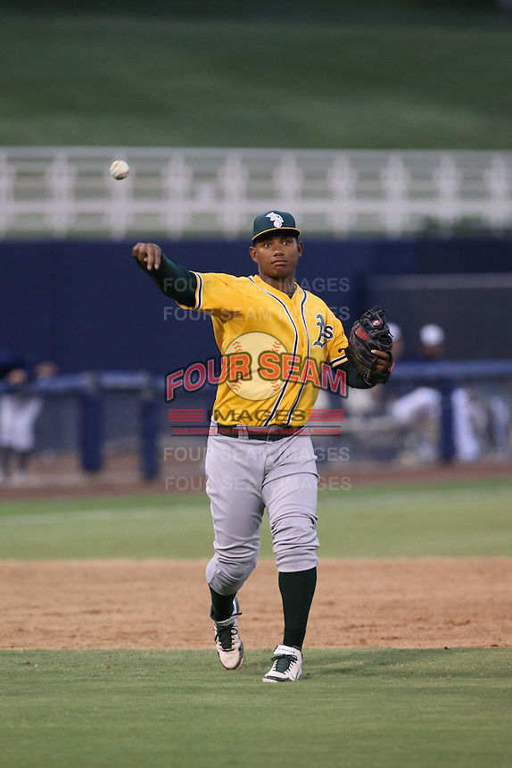 Miguel Mercedes (15) of the AZL Athletics makes a throw during a game against the AZL Brewers at Maryvale Baseball Park on June 30, 2015 in Phoenix, Arizona. Brewers defeated Athletics, 4-2. (Larry Goren/Four Seam Images)