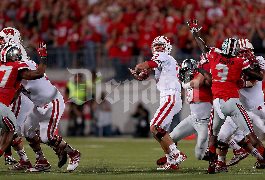 Wisconsin Badgers quarterback Joel Stave (2) prepares to throw a touchdown pass during the first half of the game between Ohio State and Wisconsin at Ohio Stadium on Saturday, September 28, 2013. (Columbus Dispatch photo by Jonathan Quilter)
