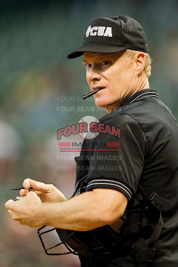 Home plate umpire Danny Mascorro updates his lineup card during the game between the Texas Longhorns and the Tennessee Volunteers at Minute Maid Park on March 3, 2012 in Houston, Texas.  The Volunteers defeated the Longhorns 5-4.  (Brian Westerholt/Four Seam Images)