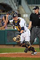 Montgomery Biscuits catcher Justin O'Conner (5) checks the runner while retrieving a pitch as umpire Alex Ransom looks on during a game against the Tennessee Smokies on May 25, 2015 at Riverwalk Stadium in Montgomery, Alabama.  Tennessee defeated Montgomery 6-3 as the game was called after eight innings due to rain.  (Mike Janes/Four Seam Images)