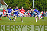 Peyer Crowley and Shane McSweeney Laune Rangers v Cormac Cronin East Kerry in the first round of the Garveys Supervalu Kerry county football championship at Beaufort on Saturday evening.