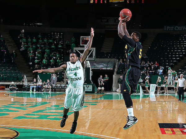 DENTON, TX - DECEMBER 16: Brandon Fortenberry #5 of the Southeastern Louisiana Lions shoots over P.J. Hardwick #4 of the North Texas Mean Green at the UNT Coliseum on December 16, 2012 in Denton, Texas. (Photo by Rick Yeatts/Getty Images)
