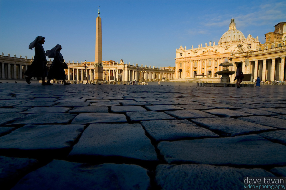 Two nuns rush across the cobblestones of St. Peter's Square early on the morning of June 30, 2005 in the Vatican City.