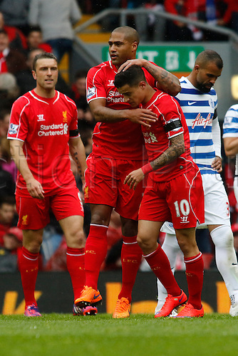 02.05.2015.  Liverpool, England. Barclays Premier League. Liverpool versus Queens Park Rangers. Liverpool defender Glen Johnson congratulates Liverpool midfielder Philippe Coutinho after his opening goal.