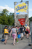 Participants queue to enter Sziget festival held in Budapest, Hungary on August 09, 2011. ATTILA VOLGYI