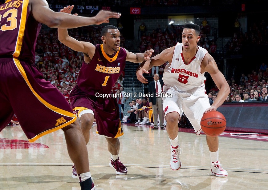 Minnesota Golden Gophers guard Andre Hollins defends against Wisconsin Badgers Ryan Evans (5) during a Big Ten Conference NCAA college basketball game on Tuesday, February 28, 2012 in Madison, Wisconsin. The Badgers won 52-45. (Photo by David Stluka)