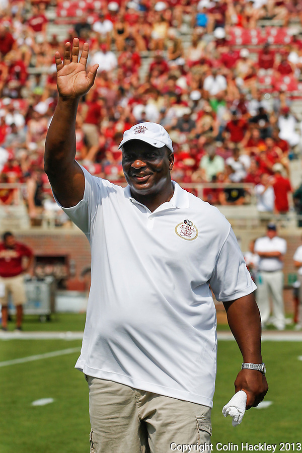 TALLAHASSEE, FLA 9/14/13-FSU-NEV091413CH-Florida State 2013 Hall of Fame Member Sammie Smith is recognized prior to the  Nevada game Saturday at Doak Campbell Stadium in Tallahassee. Smith, a running back from  was the Seminole's third all-time leading rusher with 2,539 yards.<br /> COLIN HACKLEY PHOTO
