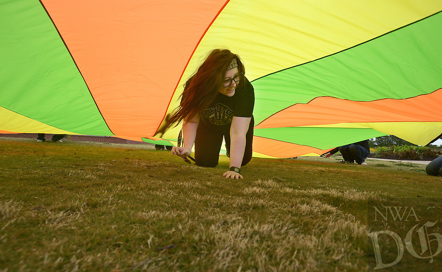 NWA Democrat-Gazette/BEN GOFF @NWABENGOFF<br /> Tori Law, Adventure Club supervisor at Mary Mae Jones Elementary, takes part in a parachute game on Thursday May 19, 2016 during a staff development outing for the Bentonville Public Schools Adventure Club program at Orchards Park in Bentonville. The staff members were learning games and activities to share with students in the before and after school program for kindergarten through 6th graders.