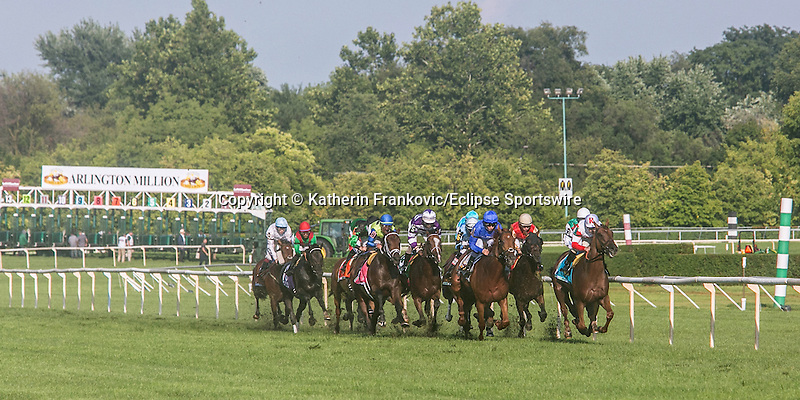 August 15, 2015. The field goes past the grandstand for the first time during the G1 Arlington Million. Katherin Frankovic/ESW/CSM