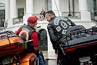 Actor Robbert Patrick, right, talks to an attendee while sitting on motorcycles during a Rolling to Remember ceremony honoring the nation's veterans and prisoners of war/missing in action (POW/MIA) in Washington, D.C., U.S., on Friday, May 22, 2020. United States President Donald J. Trump didn't wear a face mask during most of his tour of Ford Motor Co.'s ventilator facility Thursday, defying the automaker's policies and seeking to portray an image of normalcy even as American coronavirus deaths approach 100,000. <br /> Credit: Andrew Harrer / Pool via CNP / MediaPunch