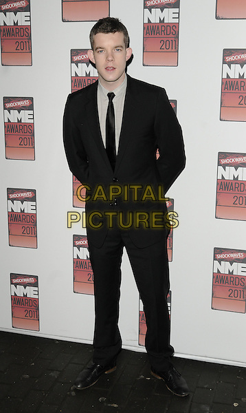RUSSELL TOVEY.The Shockwaves NME Awards 2011 held at the O2 Academy Brixton - Arrivals London, England, UK,.23rd February 2011..full length black suit grey gray shirt tie.CAP/CAN.©Can Nguyen/Capital Pictures.