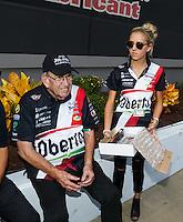 Sep 18, 2016; Concord, NC, USA; NHRA funny car team owner Jim Dunn (left) and granddaughter Johnna Dunn during the Carolina Nationals at zMax Dragway. Mandatory Credit: Mark J. Rebilas-USA TODAY Sports
