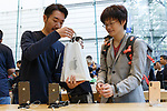 A satisfied buyer gets the new iPhone XS or iPhone XS Max at the Apple Store in Omotesando on September 21, 2018, Tokyo, Japan. Apple fans lined up patiently in the early morning rain to get the new iPhone models (XS and XS Max) and the new iWatch (Series 4). The new iPhone XS costs JPY 112,800 for the 64 GB model, the iPhone XS Max costs JPY 124,800 JPY for the 64 GB model, and iWatch Series 4 costs JPY 45,800. (Photo by Rodrigo Reyes Marin/AFLO)