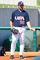 Royce Ring #50 of the United States World Cup/Pan Am Team gets warmed up in the bullpen during the exhibition game against Team Canada at the USA Baseball National Training Center on September 29, 2011 in Cary, North Carolina.  (Brian Westerholt / Four Seam Images)