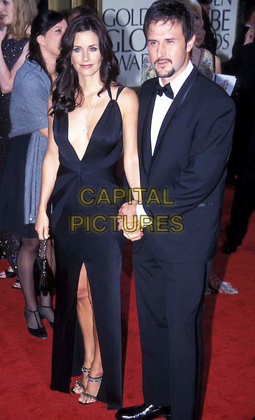 COURTENEY COX-ARQUETTE & DAVID ARQUETTE .Golden Globe Awards 2003.Ref: ND.long black dress, split, cleavage, stappy sandals, full length, full-length, plunging neckline.www.capitalpictures.com.sales@capitalpictures.com.© Capital Pictures