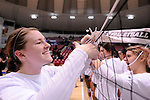 03 DEC 2011:  Taylor Fieldsted (6) of Concordia University St. Paul celebrates their victory over Cal State San Bernardino by cutting down the nets during the Division II Women's Volleyball Championship held at Coussoulis Arena on the Cal State San Bernardino campus in San Bernardino, Ca. Concordia St. Paul defeated Cal State San Bernardino 3-0 to win the national title. Matt Brown/ NCAA Photos