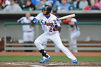 Tennessee Smokies center fielder Rubi Silva #24 attempts a bunt during a game against Huntsville Stars at Smokies Park on April 25, 2014 in Kodak, Tennessee. The Stars defeated the Smokies 15-1. (Tony Farlow/Four Seam Images)