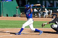 Melvin Santana (9) of the Ogden Raptors at bat against the Grand Junction Rockies on June 19, 2014 at Lindquist Field in Ogden, Utah. (Stephen Smith/Four Seam Images)