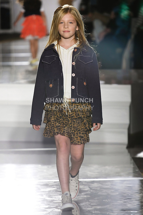 Model walks runway in an outfit by Karen Han, for the Parsons 2011 BFA Fashion Show, hosted by Reed Krakoff.
