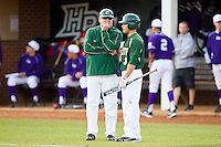 Charlotte 49ers head coach Loren Hibbs (49) talks with Michael Green (3) during the game against the High Point Panthers at Willard Stadium on February 20, 2013 in High Point, North Carolina.  The 49ers defeated the Panthers 12-3.  (Brian Westerholt/Four Seam Images)