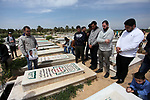 Relatives and Journalists pray over the grave of Palestinian photographer Yasser Murtaja, to mark the first anniversary of his death in Gaza city on April 06, 2019. Murtaja was killed by Israeli security forces during the 2018 Gaza border protests. Murtaja was the co-founder of Ain Media Production Company, which produced video for several international media outlets. Photo by Mahmoud Ajjour