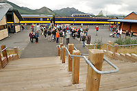 Travelers wait to board the train at the Denali Park Depot. The Alaska Railroad's Denali Star train runs between Anchorage and Fairbanks, with Denali one of the stops along the way.