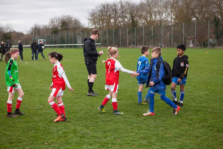 The post game hand shake. Arsenal Ladies Under 10 and AC Finchley boys team play a football game at Univeristy of Hertfordshire's campus sports village  football pitch in Hatfield.