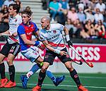 AMSTELVEEN - Justin Reid-Ross (Adam) scoort   tijdens  de hoofdklasse competitiewedstrijd hockey heren,  Amsterdam-SCHC (3-1). links Boris Burkhardt (Adam) en Caspar Dobbelaar (SCHC) . COPYRIGHT KOEN SUYK