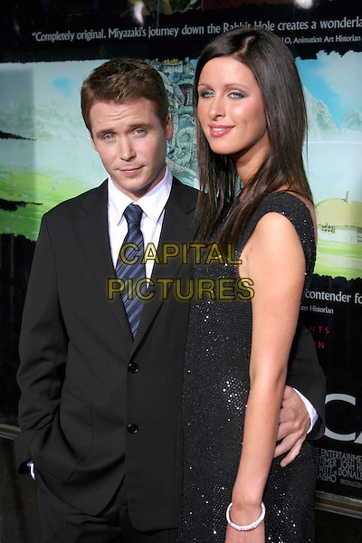 KEVIN CONNOLLY & NICKY HILTON.Premiere of HBO's series ENTOURAGE held at the El Capitan Theater, Hollywood, California.May 25th, 2005.Photo Credit: Zach Lipp/AdMedia.half length arm around waist black suit .www.capitalpictures.com.sales@capitalpictures.com.© Capital Pictures.