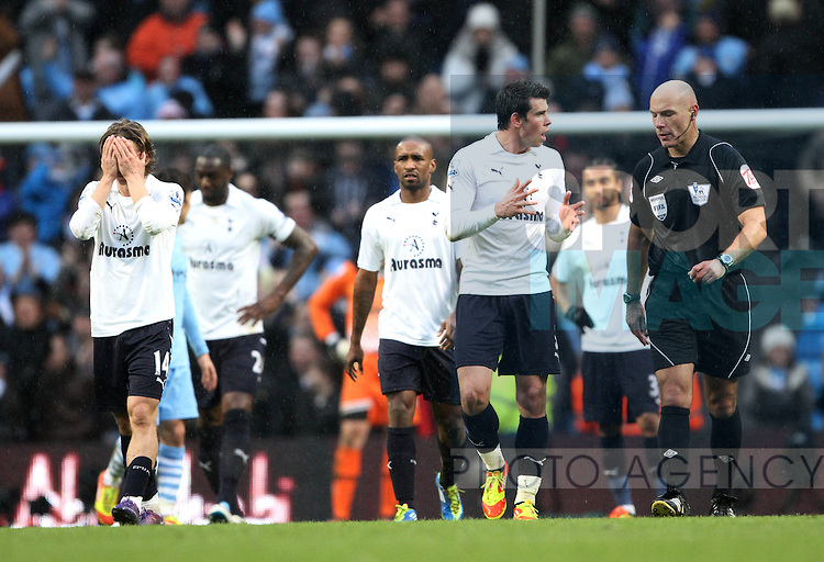 Spurs players look on dejected after going 3-2 down..Manchester City v Tottenham Hotspur in the the Barclays Premier League, at the Etihad Stadium, Manchester. 22nd January 2012.--------------------.Sportimage +44 7980659747.picturedesk@sportimage.co.uk.http://www.sportimage.co.uk/.Editorial use only. Maximum 45 images during a match. No video emulation or promotion as 'live'. No use in games, competitions, merchandise, betting or single club/player services. No use with unofficial audio, video, data, fixtures or club/league logos.
