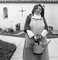 """Mother Teresita walks through the gardens on July 3, 2018.<br /> <br /> The nuns have a big patio and gardens full of bright flowers and thriving shrubs. Outside of seven group prayers a day and two daily personal prayer times, the sisters devote their hours to keeping up their home. Gardeners come once a week to tend the grounds and there is a cook (who is the wife of one gardener).<br /> <br /> """"We try to grow vegetables, but we have a gopher problem,"""" Teresita says with a laugh, holding the gate open for two nuns, """"but we (make) worm compost and have got some nice cherry tomato volunteers coming up."""""""