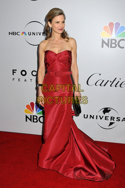KYRA SEDGWICK.NBC Universal 66th Annual Golden Globes Post Party at the Beverly Hilton Hotel, Beverly Hills, California, USA..January 11th, 2009.full length long red strapless dress gown belt black clutch bag .CAP/ADM/BP.©Byron Purvis/AdMedia/Capital Pictures.
