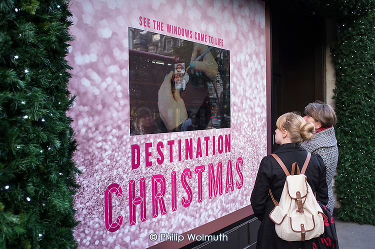 Outside the Selfridges store in Oxford Street, London, during the Christmas shopping season.