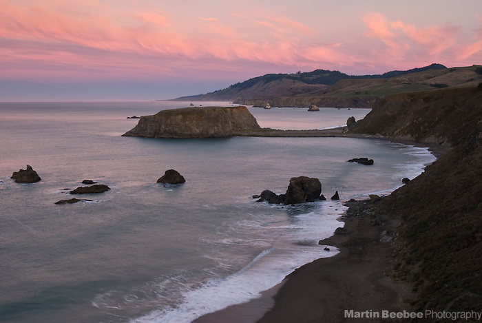 Pink dawn clouds above Goat Rock, Goat Rock State Beach, Sonoma County, California