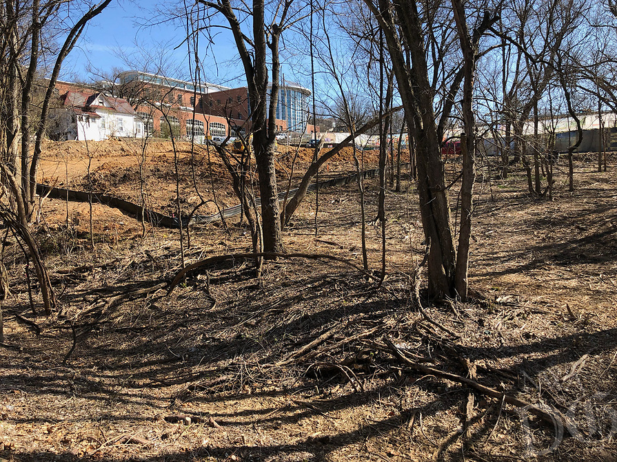 NWA Democrat-Gazette/ANDY SHUPE<br /> Construction work continues Friday, March 22, 2019, along the trail west of the Fayetteville Public Library. Voters will be asked April 9 to continue the city's 1-cent sales tax to pay for about $226 million in projects. Of that, about $30 million would go toward building an arts corridor and parking downtown. Part of the arts corridor plan includes turning the Fay Jones Parkland woods into a natural attraction with a canopy walk, trail connections and restored vegetation and streamside areas.