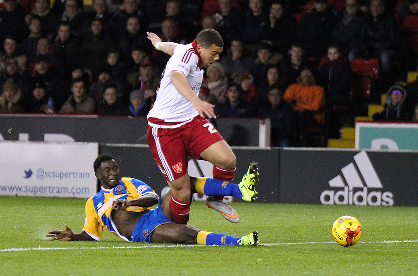 Sheffield United's Che Adams is tackled by Shrewsbury Town's Larnell Cole<br /> <br /> Photographer Rich Linley/CameraSport<br /> <br /> Football - The Football League Sky Bet League One - Sheffield United v Shrewsbury Town - Tuesday 24th November 2015 - Bramall Lane - Sheffield<br /> <br /> &copy; CameraSport - 43 Linden Ave. Countesthorpe. Leicester. England. LE8 5PG - Tel: +44 (0) 116 277 4147 - admin@camerasport.com - www.camerasport.com