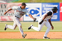 Shortstop Jonathan Schoop #46 of the Delmarva Shorebirds puts the tag on Juan Silverio #18 of the Kannapolis Intimidators during a run down at Fieldcrest Cannon Stadium on May 22, 2011 in Kannapolis, North Carolina.   Photo by Brian Westerholt / Four Seam Images