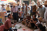 People gathered at the Fuli village weekly market, Guangxi, China.
