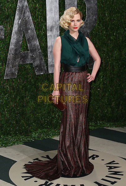 January Jones.2012 Vanity Fair Oscar Party held at the Sunset Tower, West Hollywood, California, USA..February 26th, 2012.full length green sleeveless top hand on hip brown skirt clutch bag stripe.CAP/ADM/FS.©Faye Sadou/AdMedia/Capital Pictures.