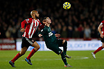 David McGoldrick of Sheffield United and Miguel Almiron of Newcastle United tussles for the ball during the Premier League match at Bramall Lane, Sheffield. Picture date: 5th December 2019. Picture credit should read: James Wilson/Sportimage