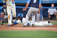 Hartford Yard Goats Juan Ciriaco (2) slides into home as Eric Ruth (8) covers during the second game of a doubleheader against the Trenton Thunder on June 1, 2016 at Sen. Thomas J. Dodd Memorial Stadium in Norwich, Connecticut.  Trenton defeated Hartford 2-1.  (Mike Janes/Four Seam Images)