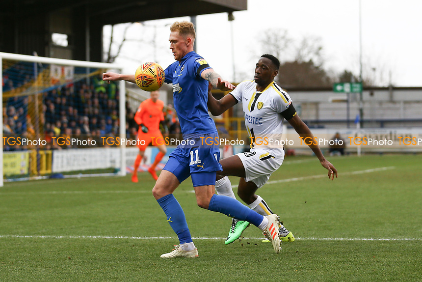 Mitchell Pinnock of AFC Wimbledon and Lucas Akins of Burton Albion during AFC Wimbledon vs Burton Albion, Sky Bet EFL League 1 Football at the Cherry Red Records Stadium on 9th February 2019