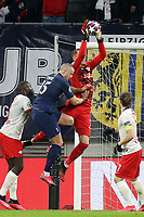 Peter Gulacsi of RB Leipzig saves ahead of Eric Dier of Tottenham Hotspur during RB Leipzig vs Tottenham Hotspur, UEFA Champions League Football at the Red Bull Arena on 10th March 2020