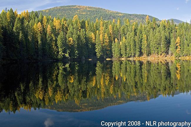 Fall colors reflecting on Robinson Lake in northern Idaho