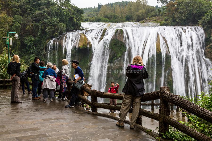 Guizhou Province, China.  Tourists at Viewing Platform, Yellow Fruit Tree (Huangguoshu) Waterfall.